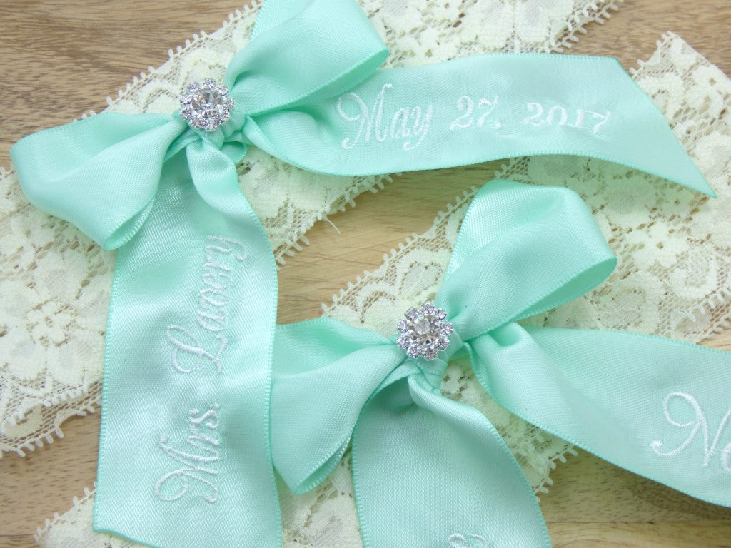 Mint green wedding garter set on ivory lace
