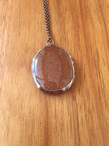 Sandstone and copper pendant