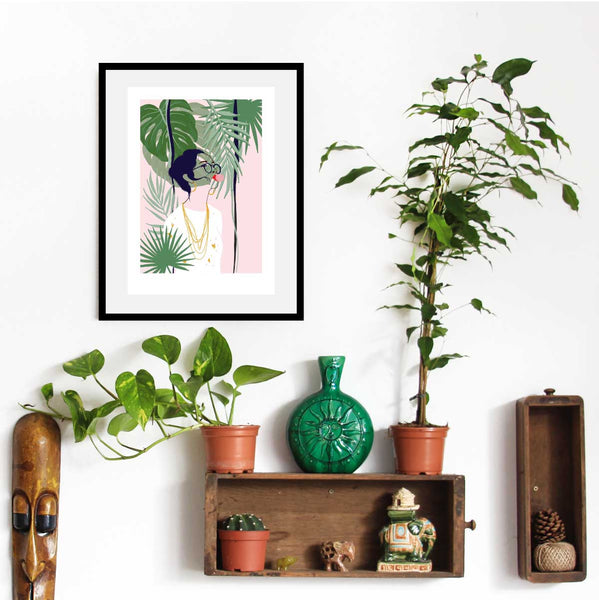Art Print of woman blowing bubbles surrounded by plants and foliage