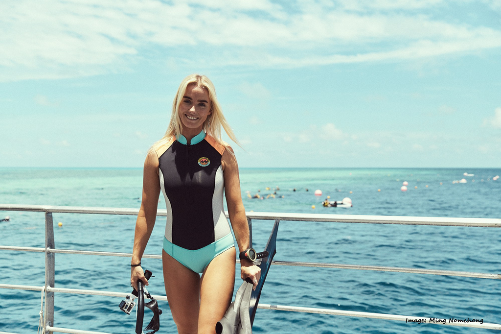 Brinkley Davies (marine biologist, freediver and surfer) featured with her custom Spierre fins