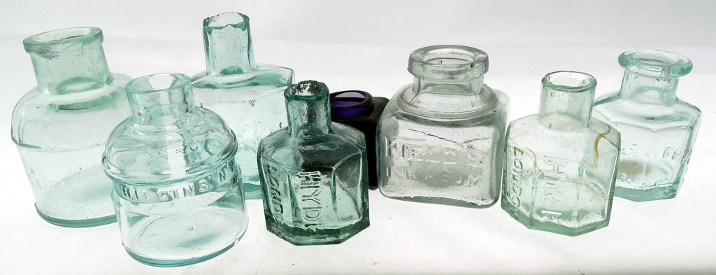 GROUP OF EIGHT INKWELLS AND MUCILAGE BOTTLES
