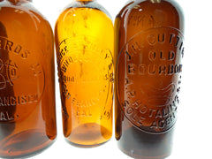 GROUP OF FIVE WESTERN WHISKEY BOTTLES