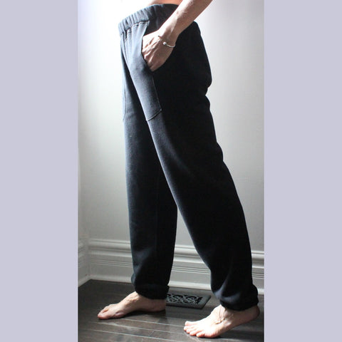 These are Black, not Pure White :-) We include this picture here so that you can see the fit of the classic track pants for women.