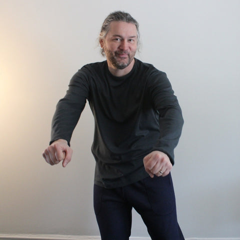 Dark Slate Grey Bamboo Thicker Long Sleeved T-Shirts for Men. Model demonstrates that the sleeves will be long enough for when he rides his bike :0)
