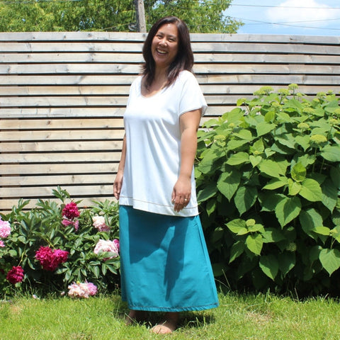 "Cotton Long Skirts in Teal<br><a href=""/products/instant-elegance-relaxed-t-shirts-bamboo"" target=""_blank"">Instant Elegance Relaxed Tees </a>in Ivory"