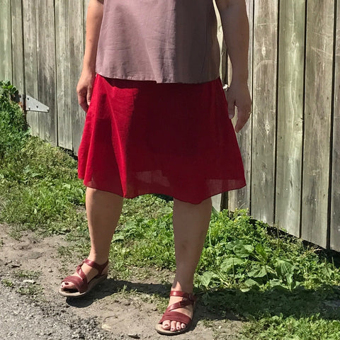 Please look very closely here - this is a single Light Weight Cotton Slip in Deepest Red. You can just barely make out the outline of the black pair of Knicker-Slips the model wears underneath :-) The top is the colour amethyst.