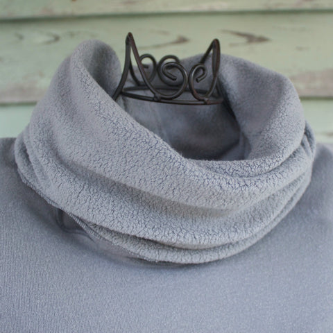Sherpa Fleece Under-Mantle in Pale Ash. The collar is turned down showing the beautiful insulating sherpa fleece finish that is on the Under-Mantles.