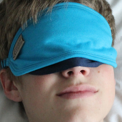 "Sleep Mask with the nose flap being utilized (it stops the light from coming in between your cheekbones and your nose). Note the cobalt blue colour of the nose flap. All the Blissfully Dark Sleep Masks have the colour dark cobalt on the inside. *Please note, the colour of this sleep mask is ""turquoise"" we are very sorry, turquoise is no longer available."