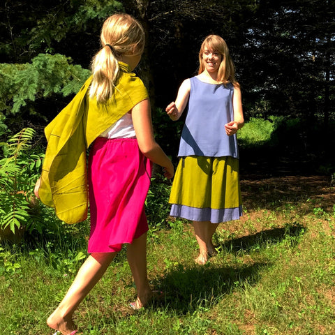 2 Light Weight Cotton Slips layered together as a skirt - shorter length in Shanti Green and longer length in Steel Blue, Reversible Sleeveless Top in Steel Blue with Maroon on the inside<br>Little Girl with Sunset Pink Slip and a Shanti Green Devinity Scarf