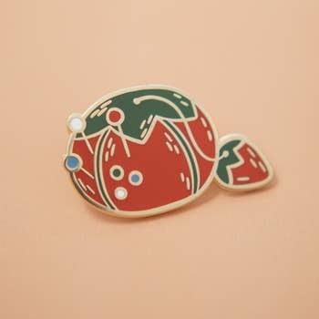 "Justine Gilbuena - Tomato Pin Cushion Enamel Pin, .75"" long x 1.25"" wide"