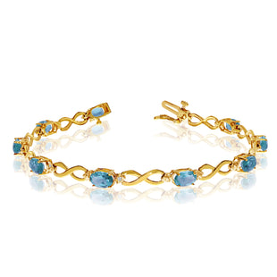 14K Yellow Gold Oval Blue Topaz Stones And Diamonds Infinity Tennis Bracelet, 7""