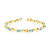 14K Yellow Gold Oval Aquamarine Stones And Diamonds Tennis Bracelet, 7""