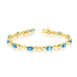 14K Yellow Gold Oval Blue Topaz Stones And Diamonds Tennis Bracelet, 7""