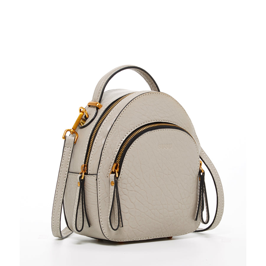 beige small leather backpack