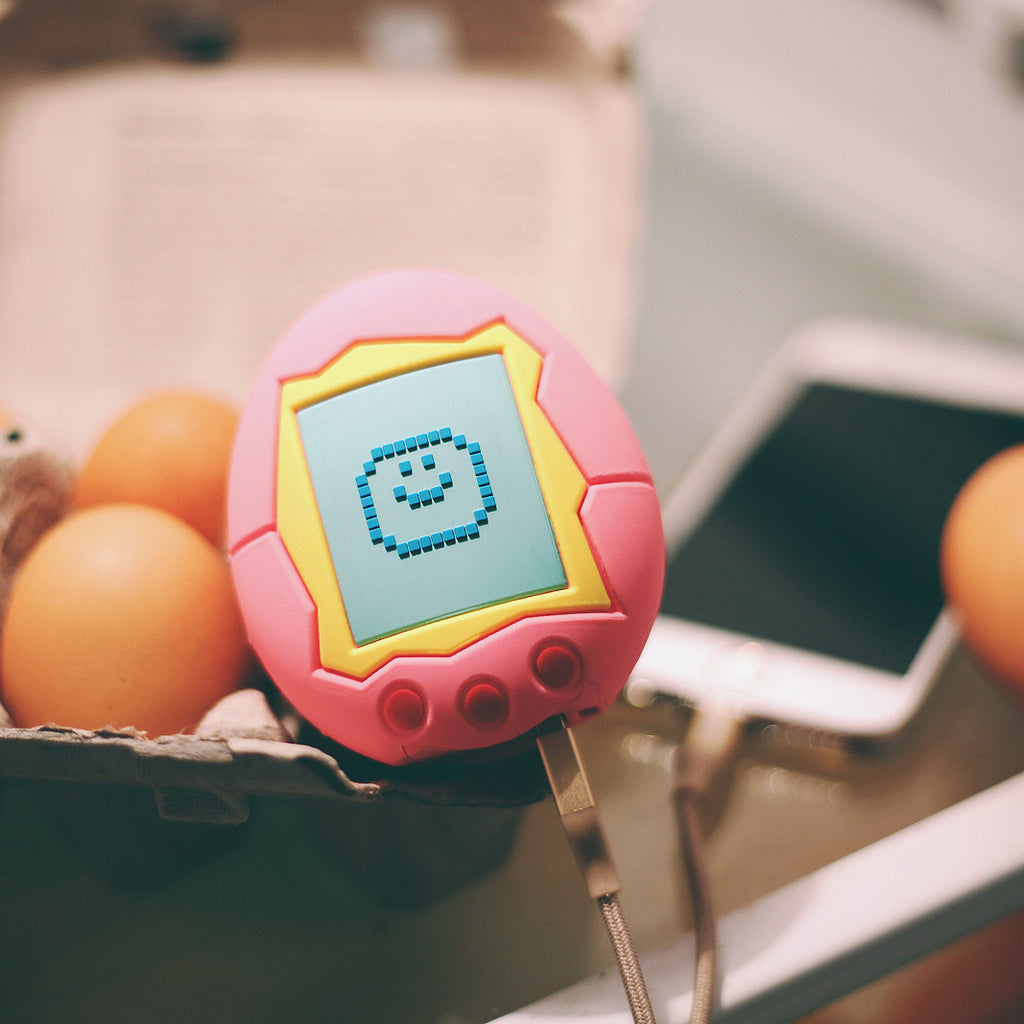 Remember when eggs were hatched on a keychain and not on Pokemon Go?  The Digibae USB Charger takes you back to the 90