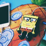 SpongeBob USB Powered iPhone Portable Charger by WattzUp Power for Story + Nickelodeon.  This NickToons themed power bank is the perfect gift for any SpongeBob SquarePants cartoon fan.