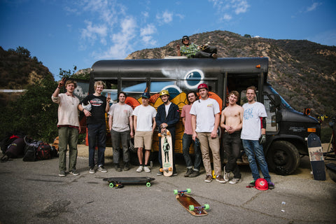 The Migrate To Skate crew standing in front of the Aeon Skate Co. bus in sunny Malibu California