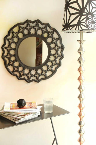 wall mirror and floor lamp