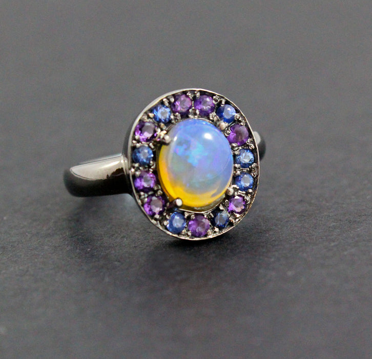 Australian jelly opal with amethyst and blue sapphire halo oxidized black gold ring
