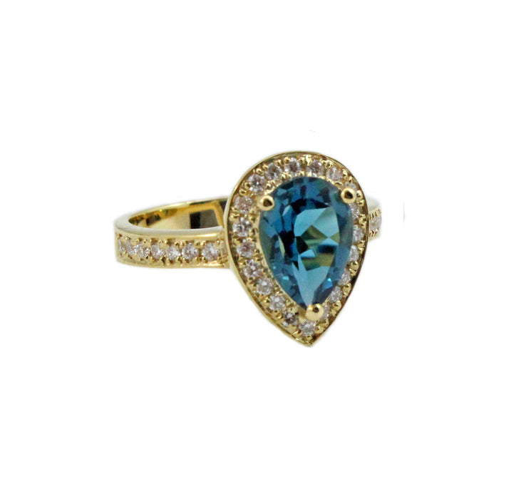 London blue topaz pear with diamond halo set in yellow gold ring
