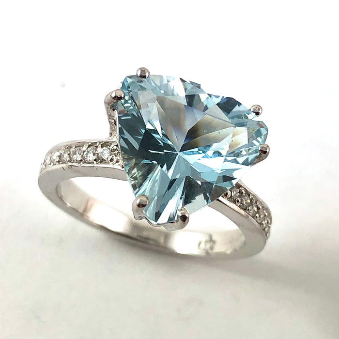 Natural untreated blue topaz trillion white gold and diamond ring