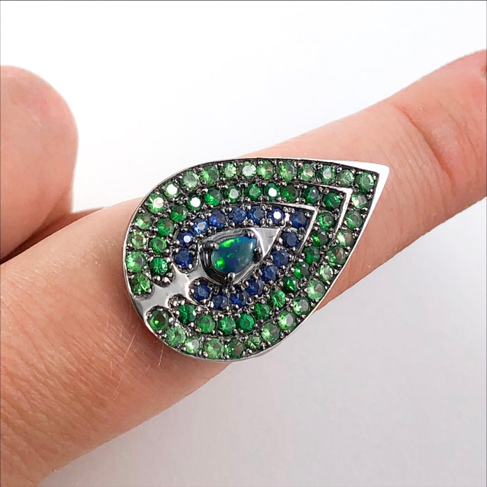 Opal tsavorite garnet blue and green sapphire black gold peacock statement ring