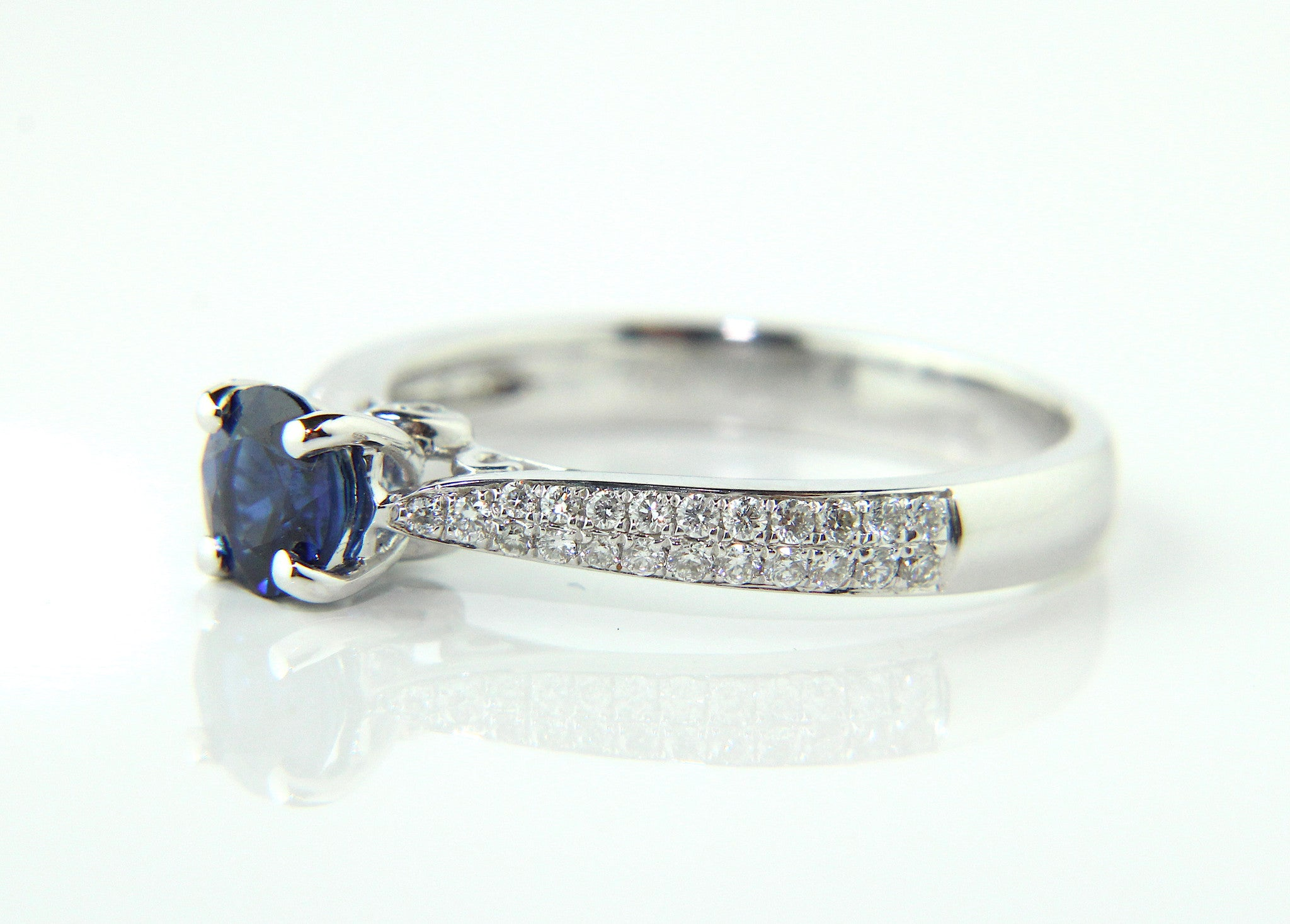 ring halo and nava platinum vs solitaire g sapphire blue in diamond h