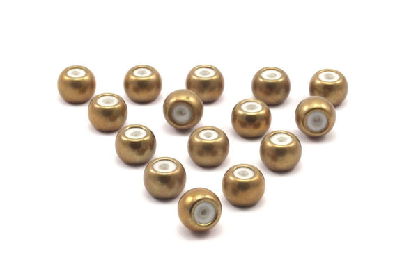 12 Raw Brass Bead keeper, silicone and  brass, (6x8mm) rondelle with 3.5mm hole Y263