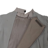 UNDERCOVER SILK BACK DOUBLE CURVE ZIP BLOUSE WITH TUXEDO PLEATED DETAIL