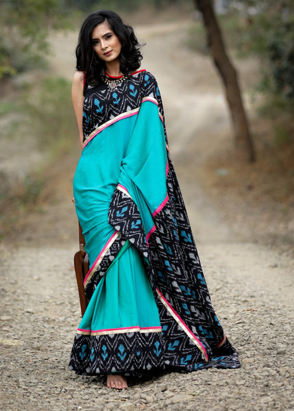 Exclusive crepe satin saree with ikat border & pallu