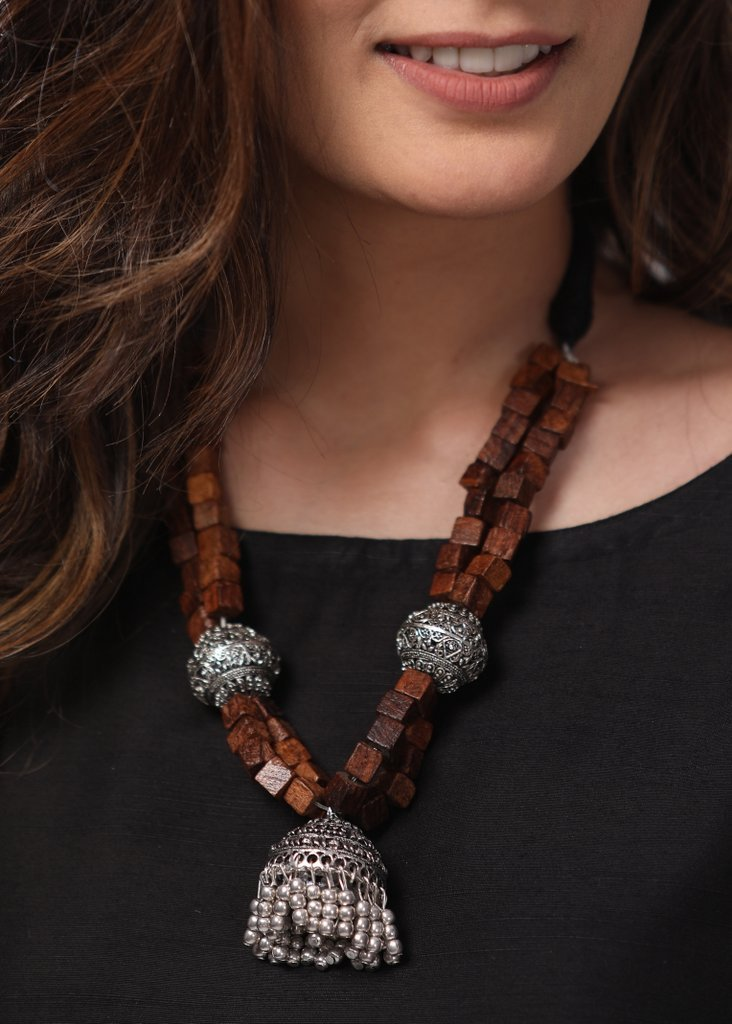 Exclusive neckpiece with wooden beads, oxidised balls and german silver traditional pendant