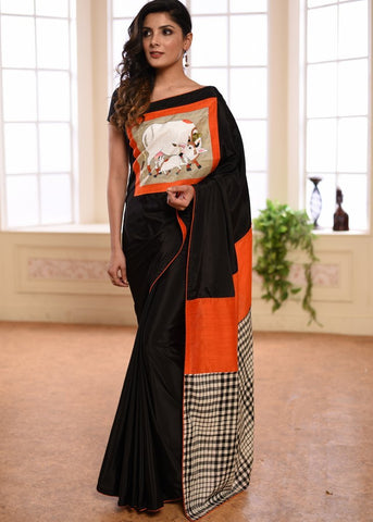 Black french crepe with hand painted patch on front & checks handloom cotton pallu