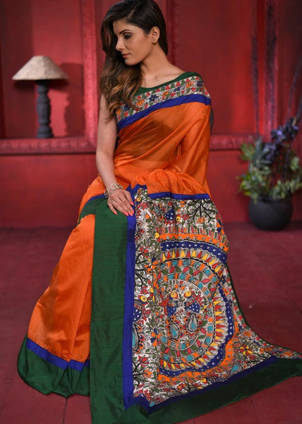 Orange chanderi saree with intricate hand painted madhubani painted pallu & border