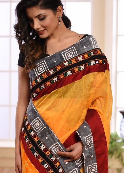 Yellow chanderi saree with kutch mirror work & batik printed border with shibori work rayon pallu