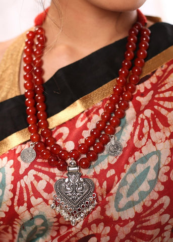 Double layered red beads neckpiece with silver oxidised pendant
