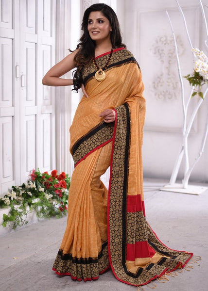 Exclusive chequred pure linen saree with block printed ajrakh border