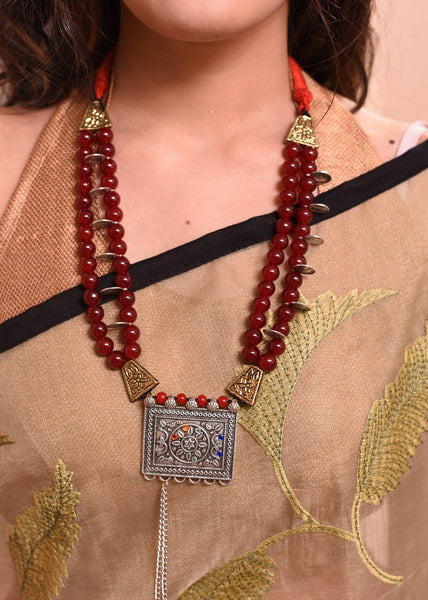 Maroon glass beaded necklace with german silver pendant - Sujatra