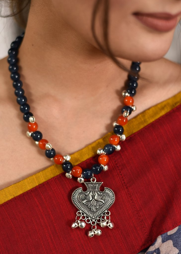 Exclusive glass bead necklace with german silver pendant & ghungroo tassel - Sujatra