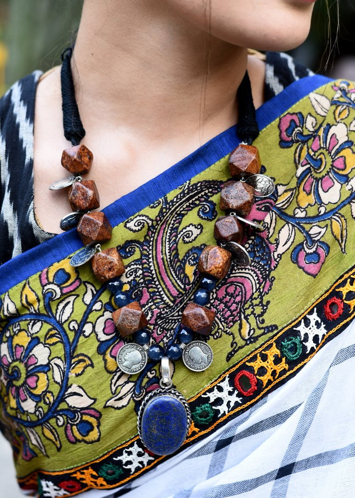 Exclusive wooden beads and coin tassels with blue stone pendant