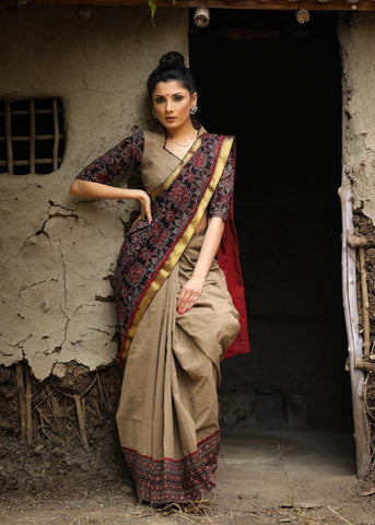 Beige handloom cotton and block printed ajrakh combination saree with traditional zari border