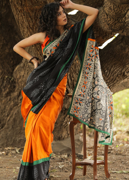 Exclusive black ikat & orange satin pleats saree with hand painted madhubani pallu
