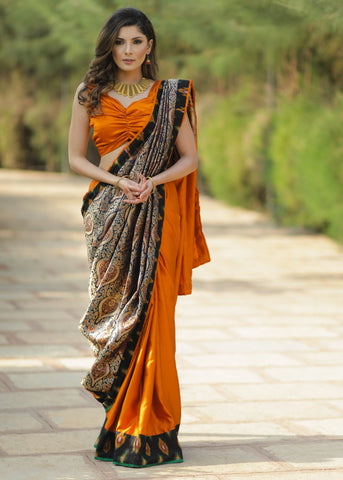 Exclusive heavy benarasi combination saree with bright rust satin pleats & ikat border
