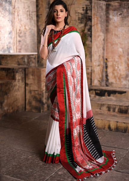 White handloom cotton saree with exclusive woven motif with ikat blouse piece - Sujatra