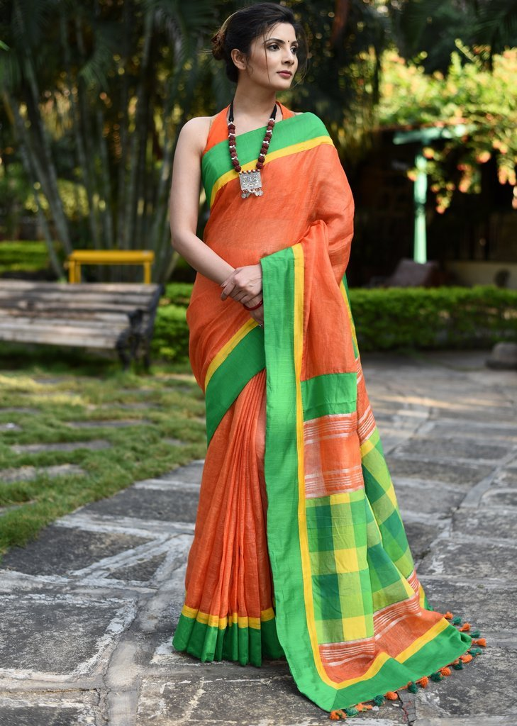 Orange pure linen saree with handloom cotton patch on pallu
