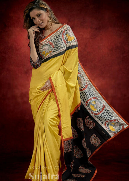 Mustard tussar staple silk saree with hand painted Madhubani border & Ajrakh pallu