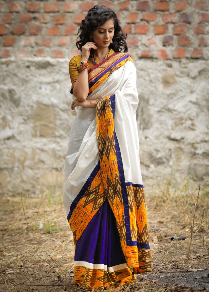 Combination of white chanderi & blue khun saree with ikat border & pallu