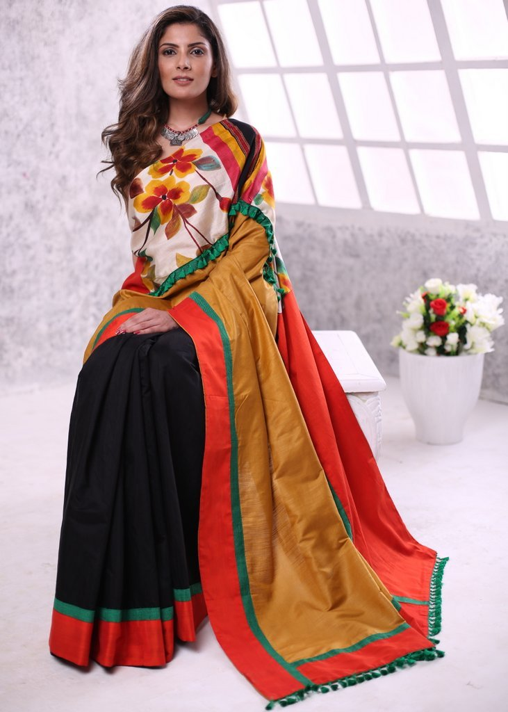 Printed silk border with orange semi silk combination saree with black chanderi