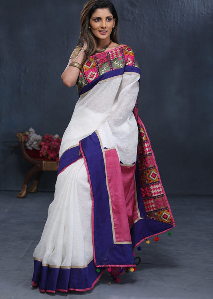 Exclusive Pure white linen saree with embroidered border - Sujatra