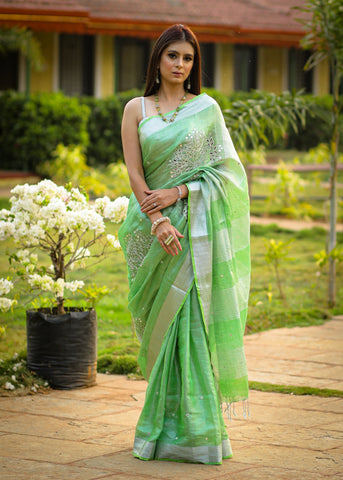 Exclusive pure silk linen pista green  cutwork saree with mirror work embellishments