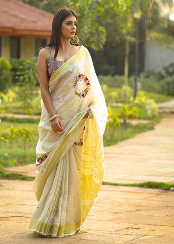 Exclusive beige  pure linen saree with intricate embroidery & mirror work embellishments